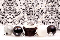 Chocolate Cupcake Against An Elegant Background With Christmas O